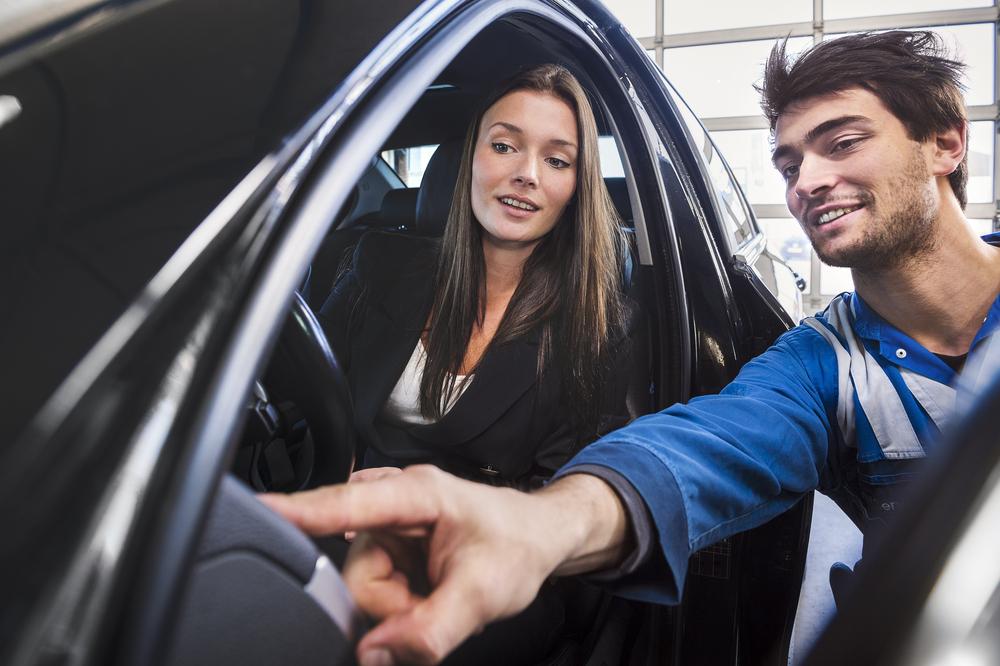 Happy Woman Having Car Fixed