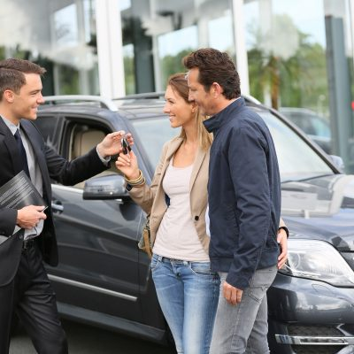 Woman Buying Car with Friends Help